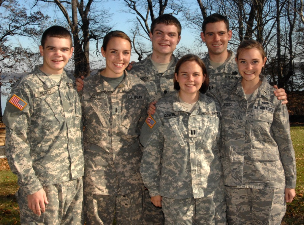 Capt. Kate Gowel, bottom row, left, poses for a picture with her siblings at her parents' home in Lorton, Va. Gowel, a military lawyer, was the first of six siblings to join the military.