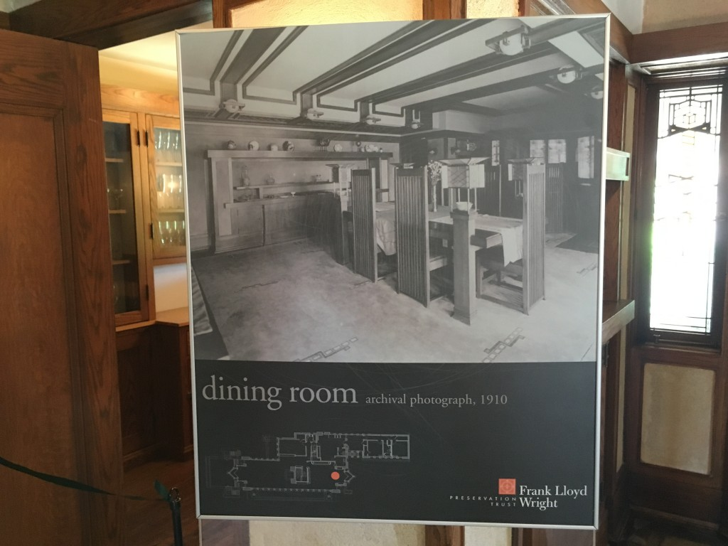 "Photograph of original FLW Robie house furniture, dining table with tall back chairs. Notice the smaller table behind. The architect was concerned with making ""rooms within rooms"" to break down large spaces."